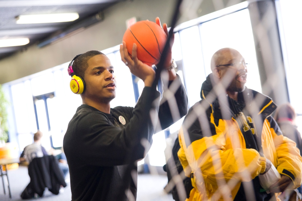 A student plays an indoor basketball game.