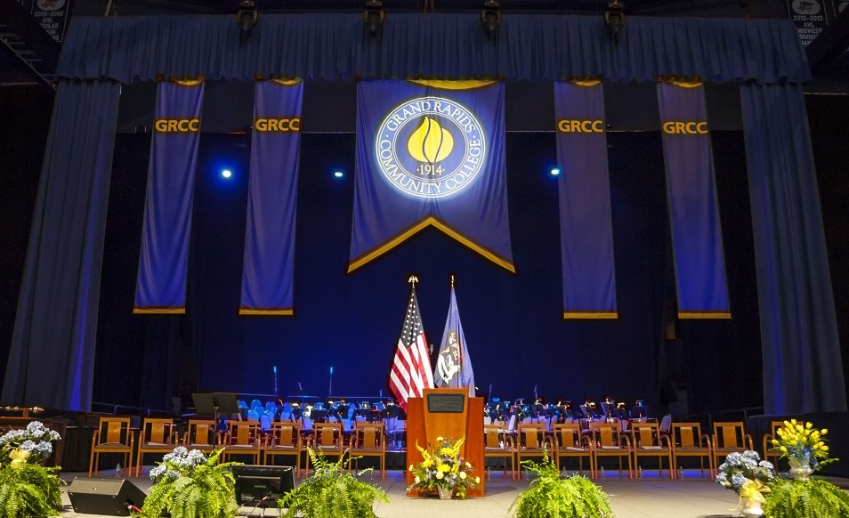 An empty stage, featuring GRCC banners.