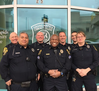 Campus Police officers stand outside their headquarters.