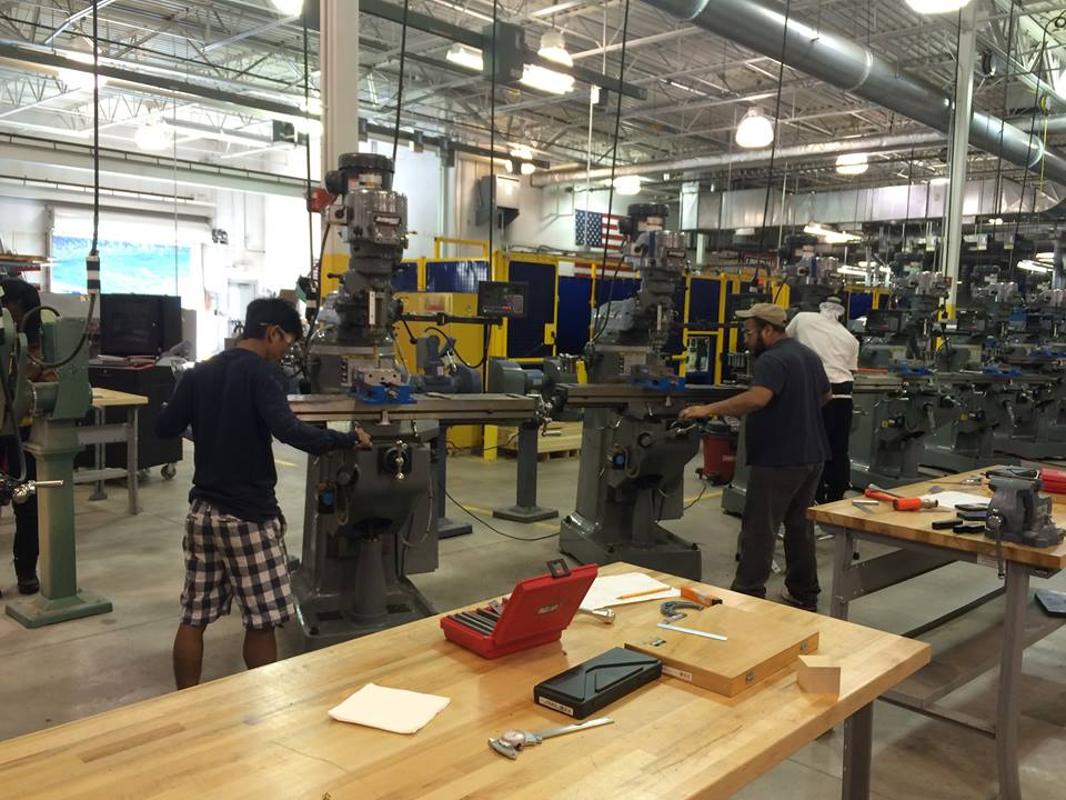 Two men work with metal at Tassell M-TEC.