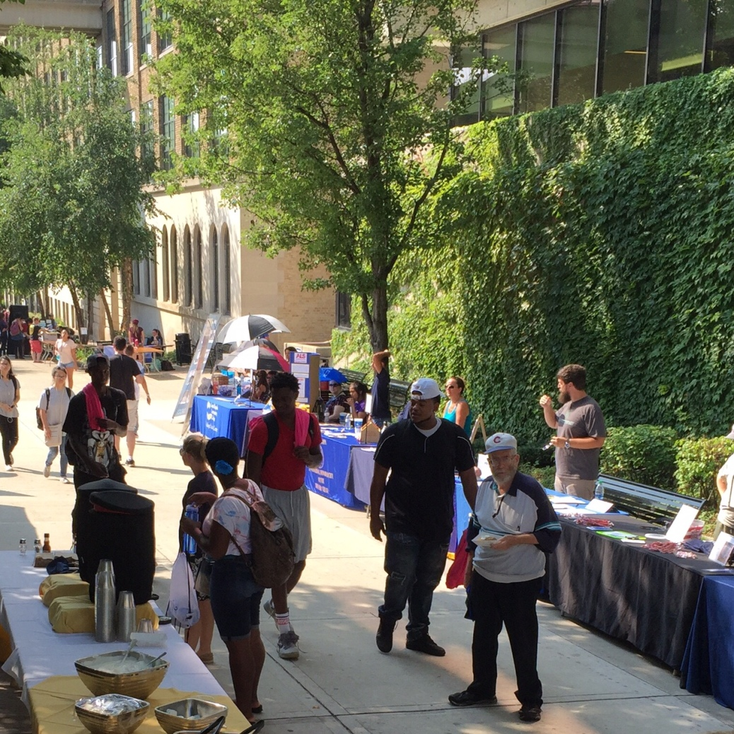 Students visit tables for different groups during Club Day on the Student Plaza.