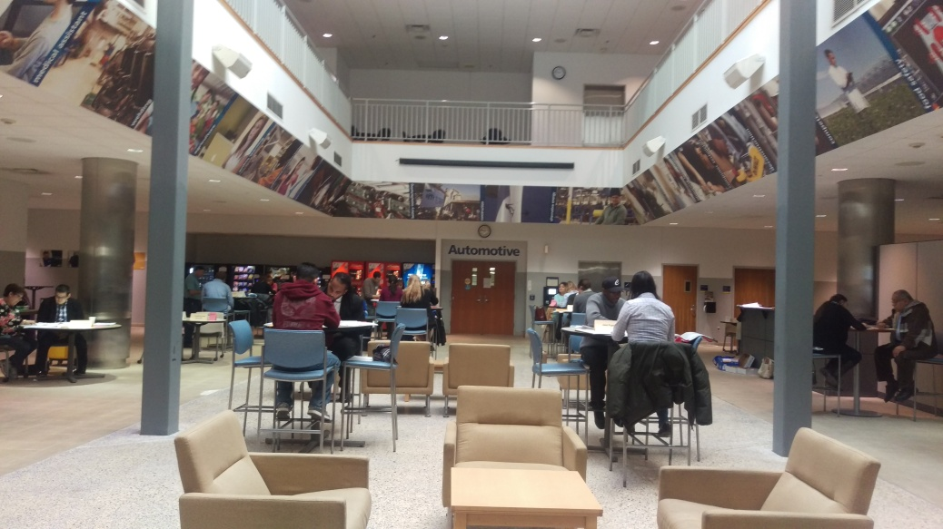 Students study in the central lobby area of Tassell M-TEC.