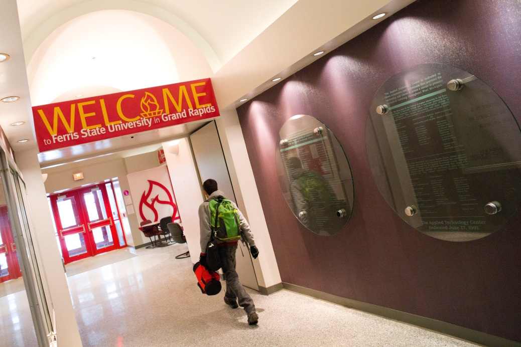 A student walks in the Ferris State University wing of the ATC building.