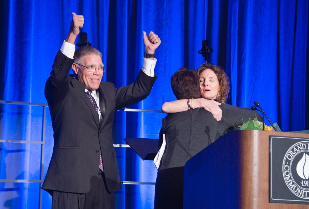 President Ender gives two thumbs up as Kathy Mullins hugs Karen Ender.