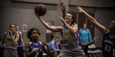 A GRCC woman's basketball player grabs the ball.