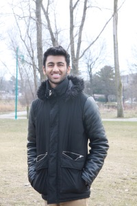 Arvinder Singh stands in a park.