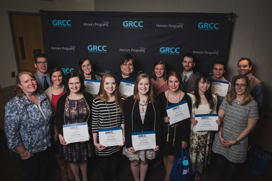 Ten Honors Program students hold up their certificates as they stand with Lynnae Selberg, Michael Schavey and two other staffers.