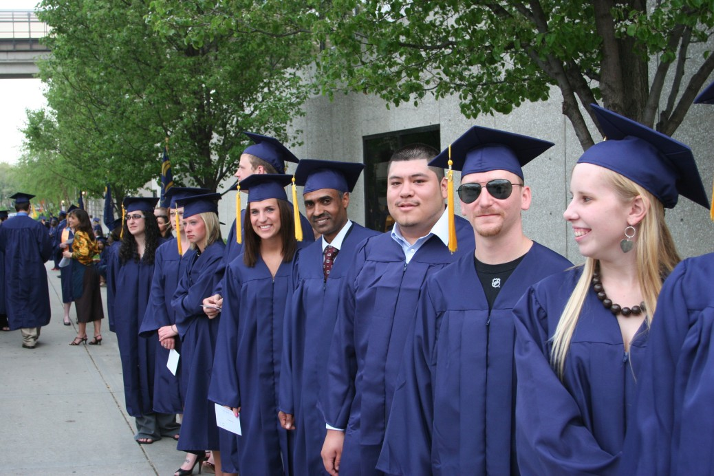 GRCC graduates stand in a line on the Student Plaza