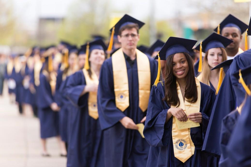 GRCC graduates line up outside.