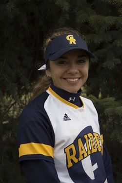 Arica Vasquez in her softball uniform