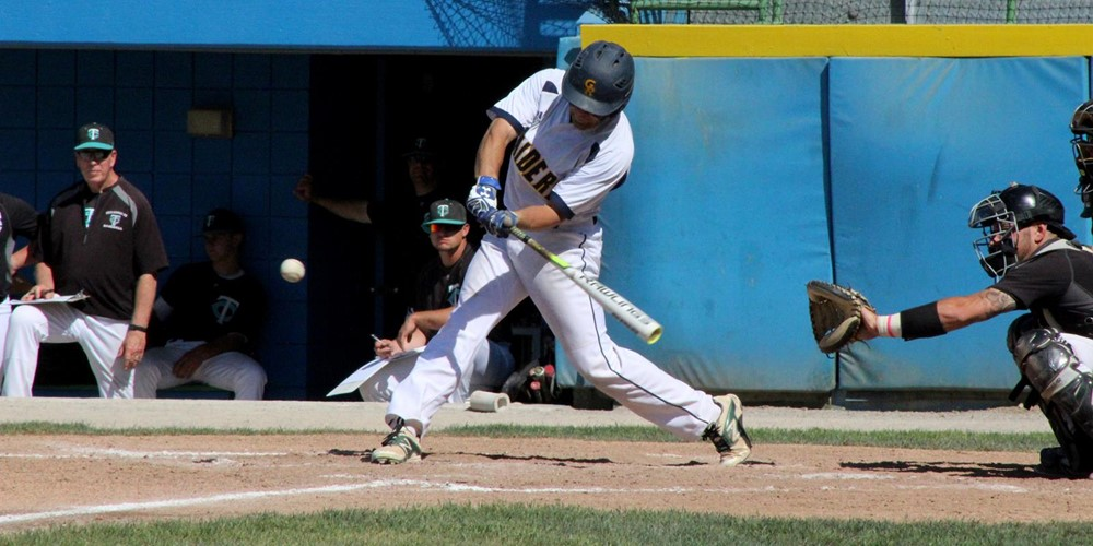 A GRCC baseball player swings at a pitch.