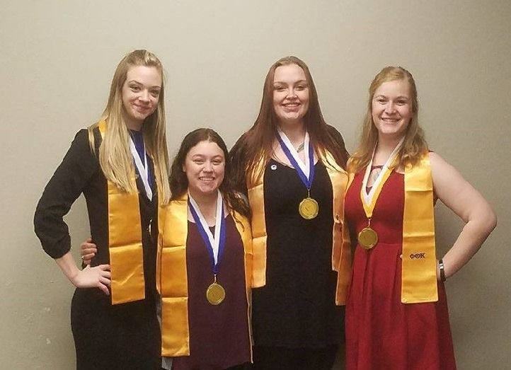 The four Phi Theta Kappa regional officers.