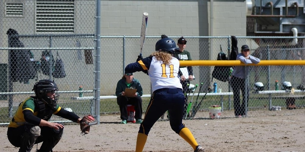 A GRCC softball player is up to bat.