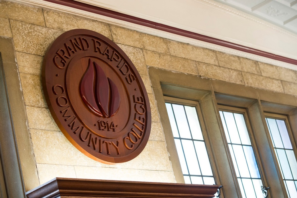 Grand Rapids Community College's seal is on a wall over a shelf in the board of trustees meeting room.