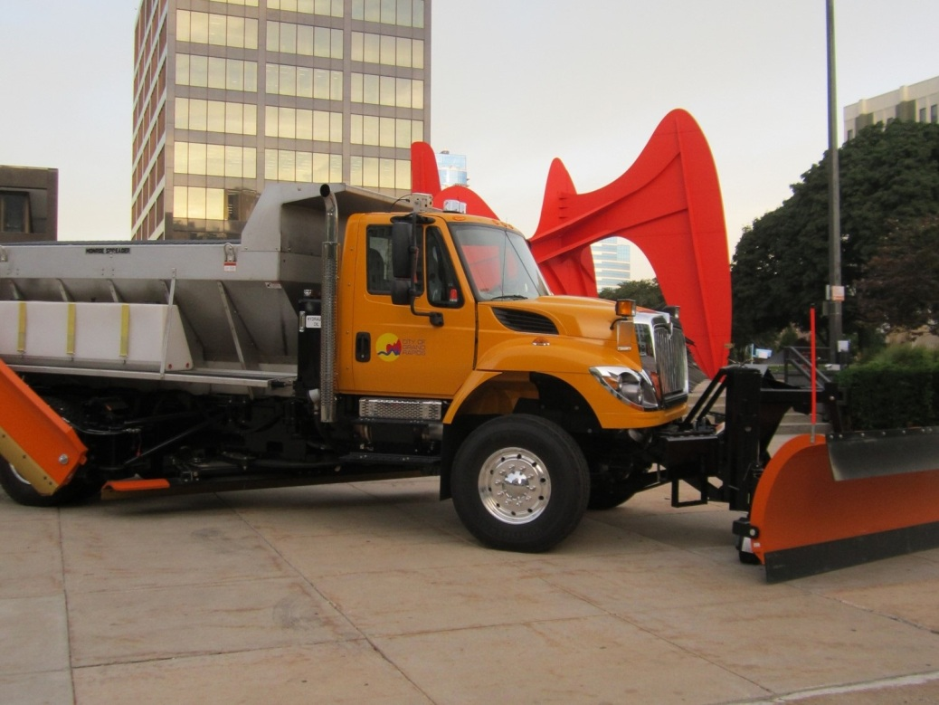 A city of Grand Rapids dump truck, with a snowplow attachment, sits on Calder Plaza.