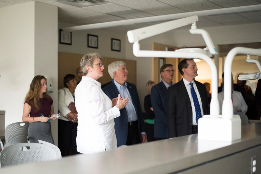 Eve Sidney talks about the dental hygiene classroom to Gov. Rick Snyder; Roger Curtis, director of the state Department of Talent and Economic Development; and U.S. Secretary of Labor Alexander Acosta.