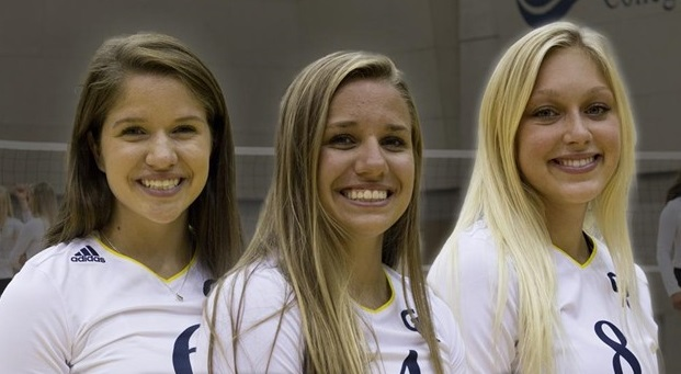 Peyton Helsen, Lauren Helsen and Hannah Stearns stand on the volleyball court