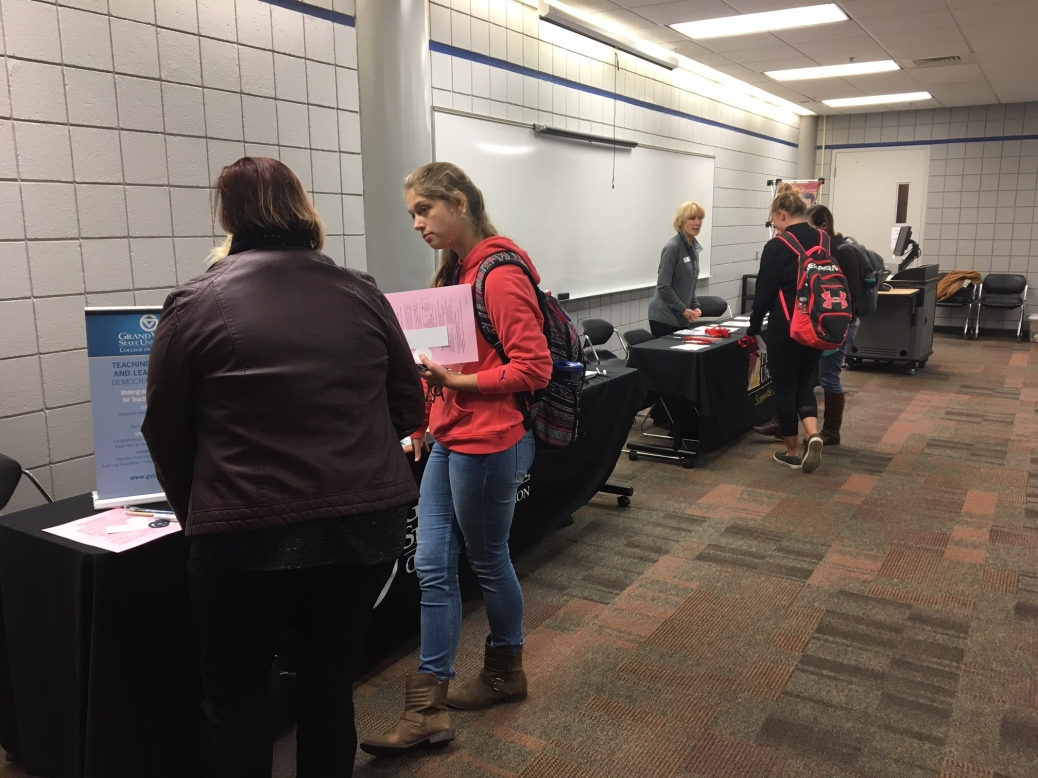 Students talk to transfer reps from different schools.