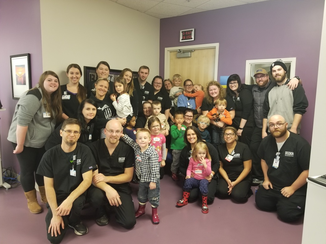 Radiologic technology students pose with the preschoolers.
