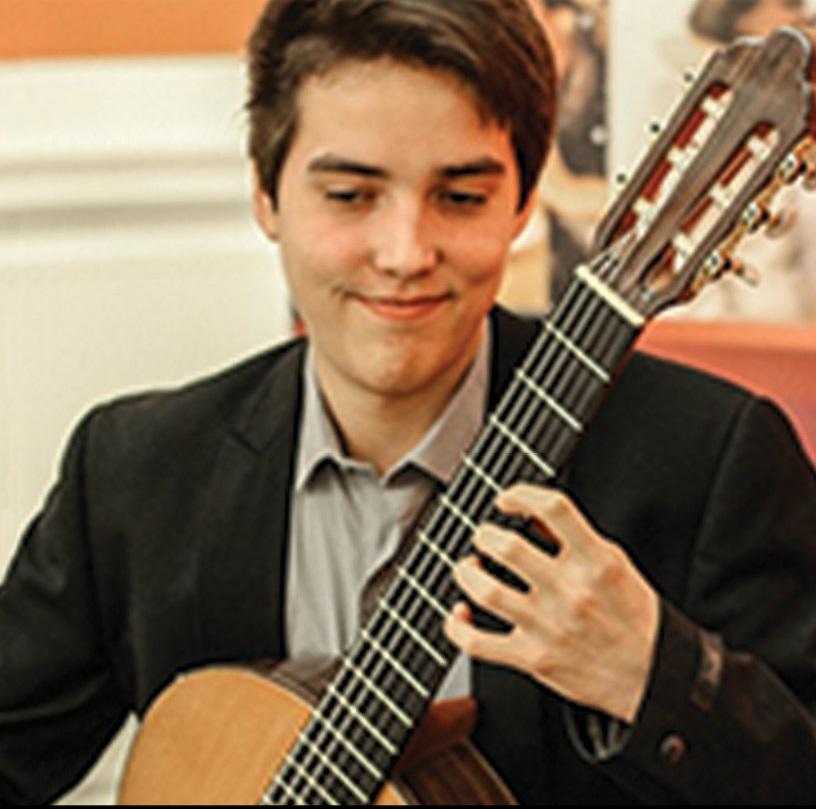 Xavier Jara plays the guitar.