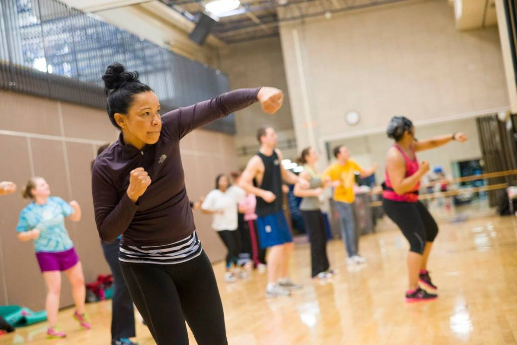 Students participate in a cardio-boxing class.