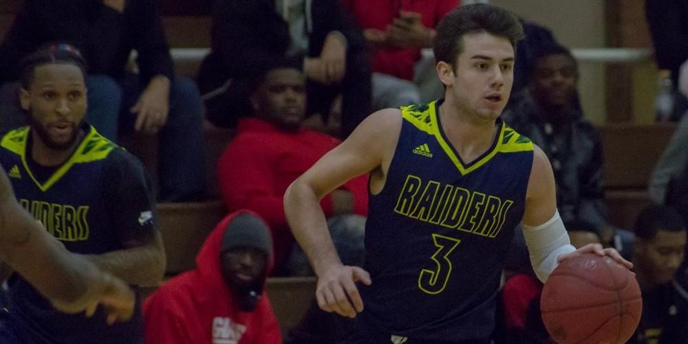 Zachary Pangborn dribbles the ball.