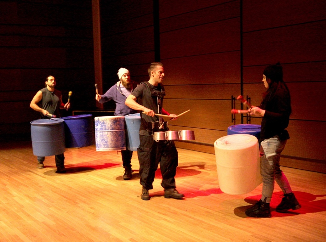"""Four cast members of """"STOMP"""" play drums made from pans and plastic buckets."""