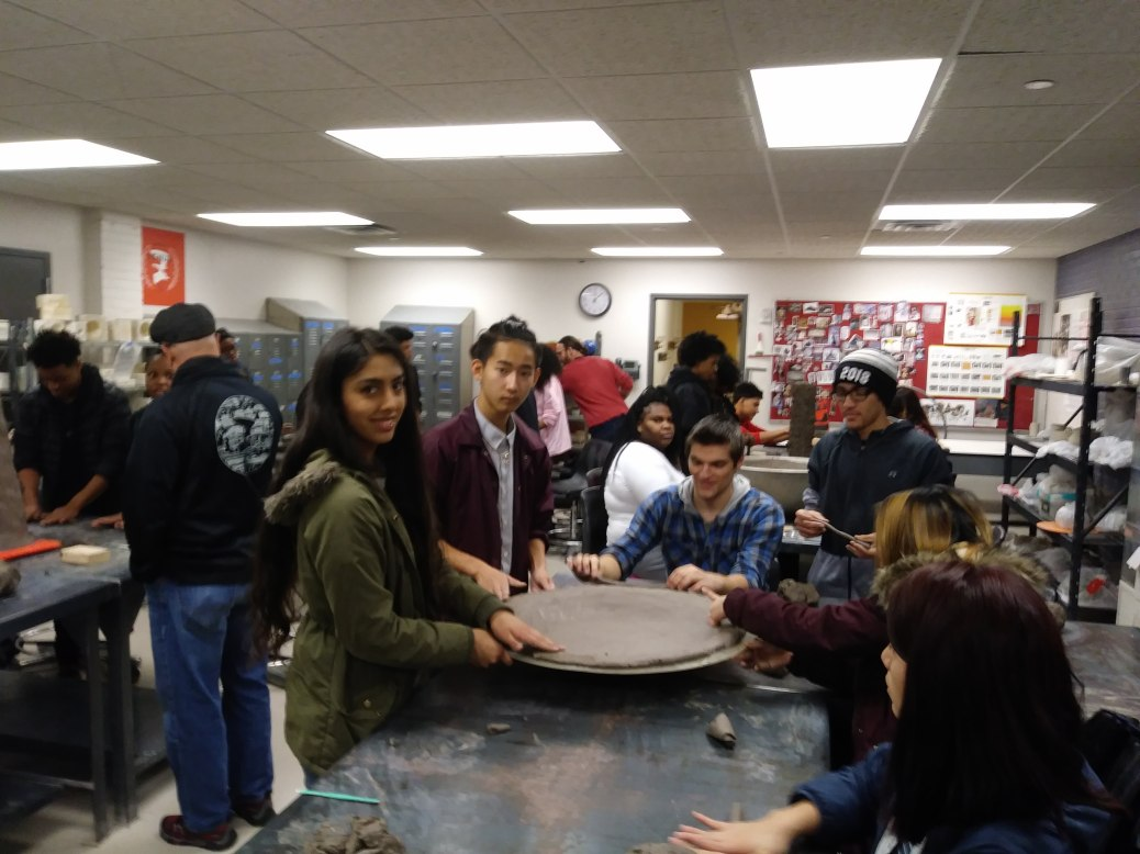 High school students work with clay.