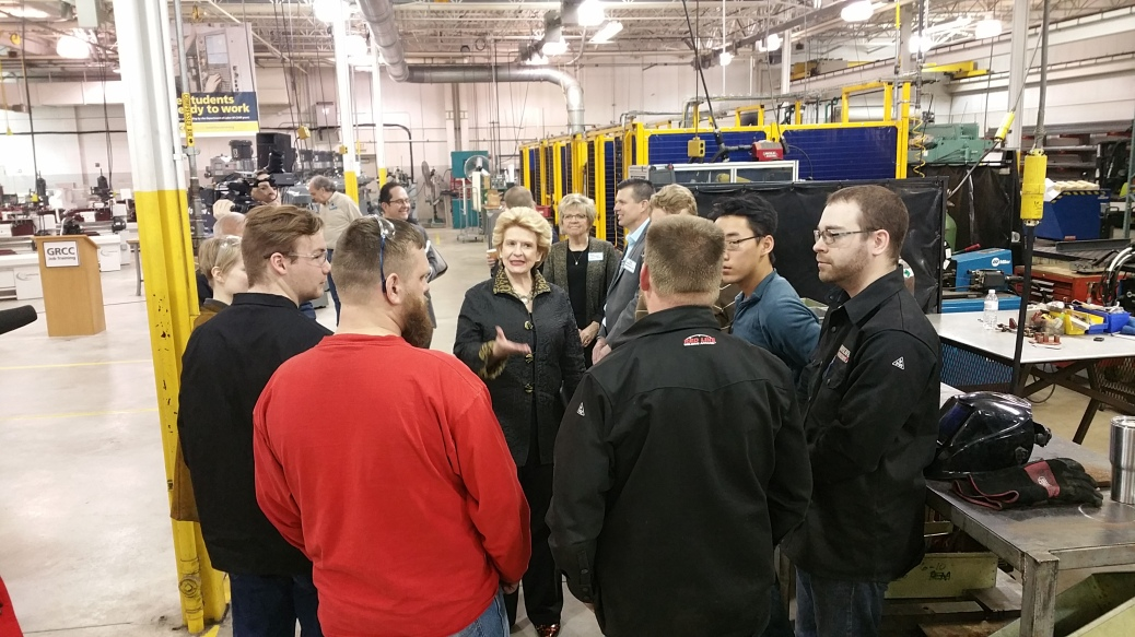 Sen. Stabenow talks to welding students at the M-TEC.
