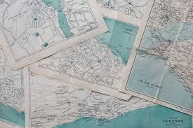 Maps lay on top of each other.