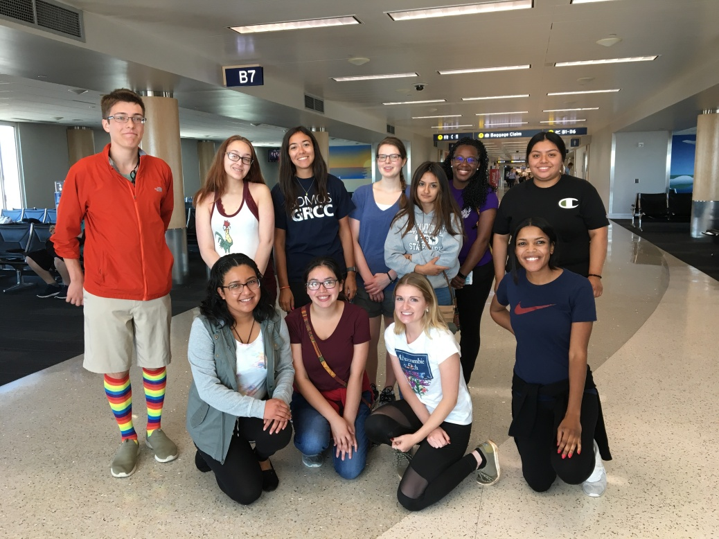 A group of students pose by Gate B7 at Ford Airport.