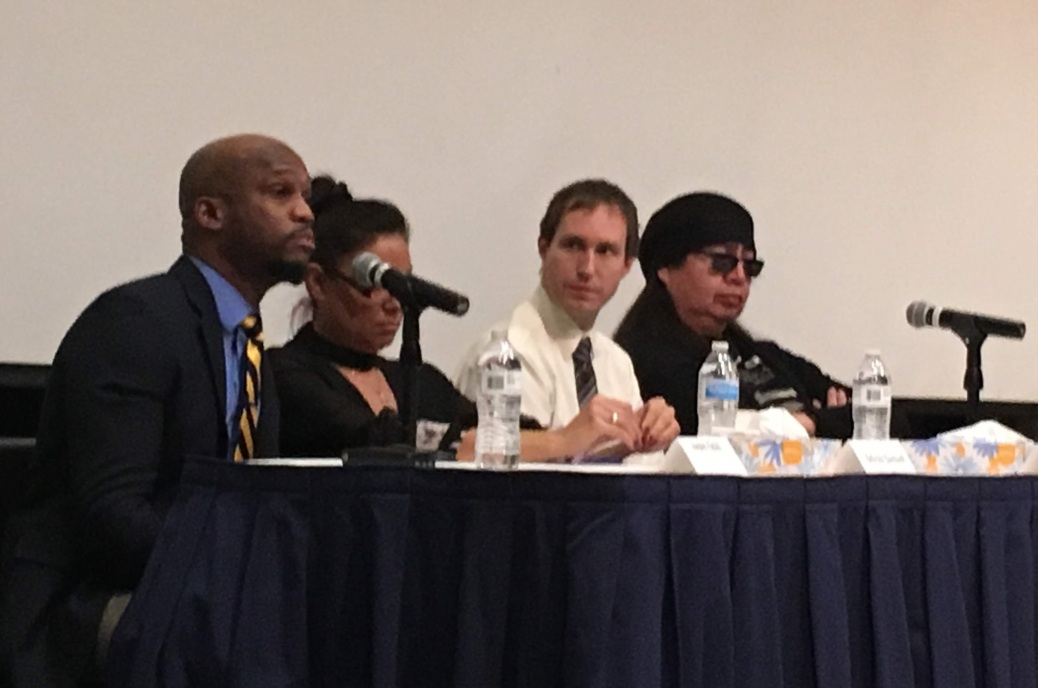 Panelists, from left: Andre Fields, Belinda Bardwell, Dillon Carr and Lynn LaPointe sit behind a table of microphones.