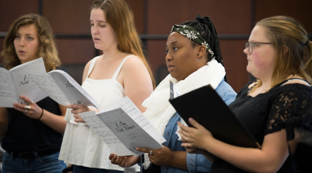 Four members of the Madrigal Singers rehearse in the Recital Hall.