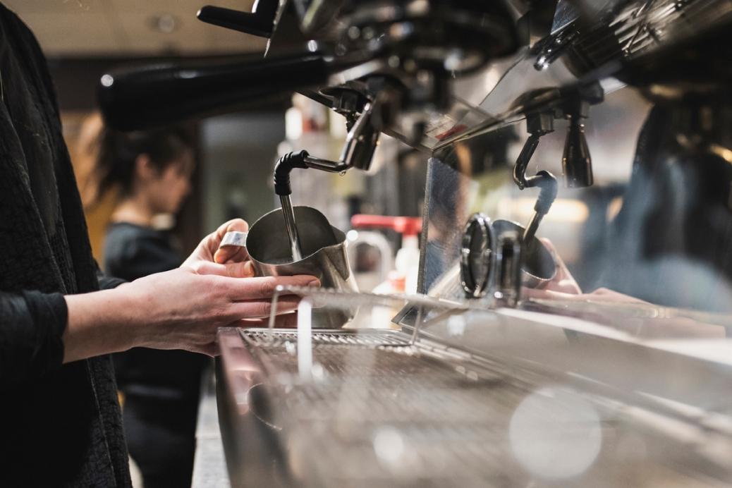 A Quiet Cafe employee makes an espresso.